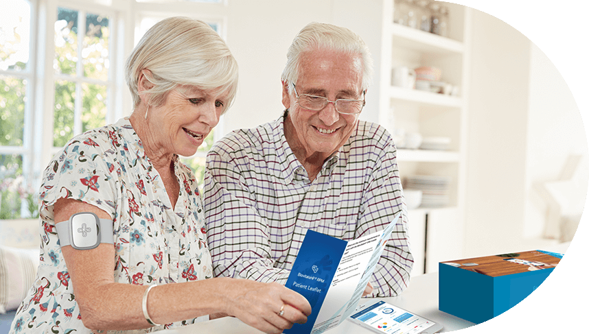 man and woman reading brochure